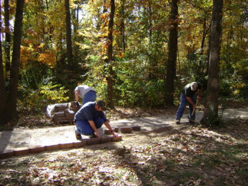 The Arkansas State University ATA and the Arkansas Forestry Commission working on the walkway